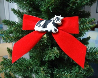 Black and White Cow on Red Bow Christmas Pin