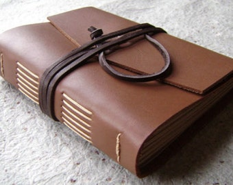 "Leather journal, approx. 4""x 6"", rustic caramel brown, handmade journal by Dancing Grey Studio on Etsy (2010)"
