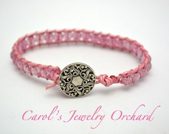 In the Pink Woven Bracelet. Button Clasp with Frosted Pink Czech Glass Beads Woven together w/ leather & silk cording for a unique bracelet