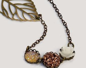 Leaf, Rose and Faux Druzy Necklace, Antiqued Brass Finish, Citrine and Rose Bronze Glitter, Frosty White Rosette, Skeleton Leaf