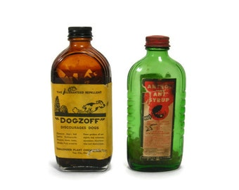 Vintage pair of Garage Bottles Dogzoff and Antrol Ant Syrup