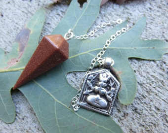 Goldstone pendulum with a Sterling chain  Sterling India Kali pendant on the end