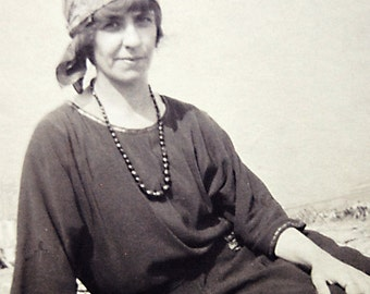 Vintage Old Photo Woman in Boho Bandana Head Scarf Relaxing Outdoor 1930s Fashion Photograph.