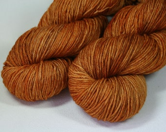 Butterscotch - Pendragon BFL sport weight hand dyed yarn orange brown kelpiefibers