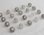 20 beautiful semi transparent glass buttons - diff. silver colored trim and each button with a beautiful rhinestone -