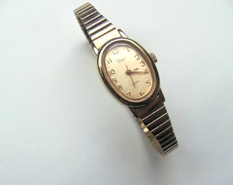Vintage women's Timex watch, gold tone, stretch band, bracelet style wrist watch