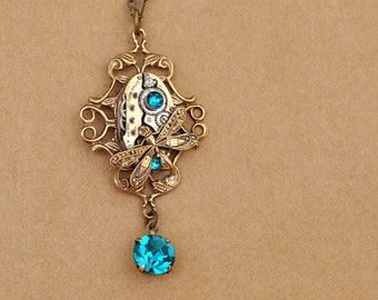 steampunk necklace,  ENCHANTED FOREST,  vintage jeweled watch movement and Swarovski blue zircon glass jewel and dragonfly charm