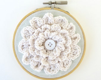 embroidery hoop art with crochet flower and recycled button