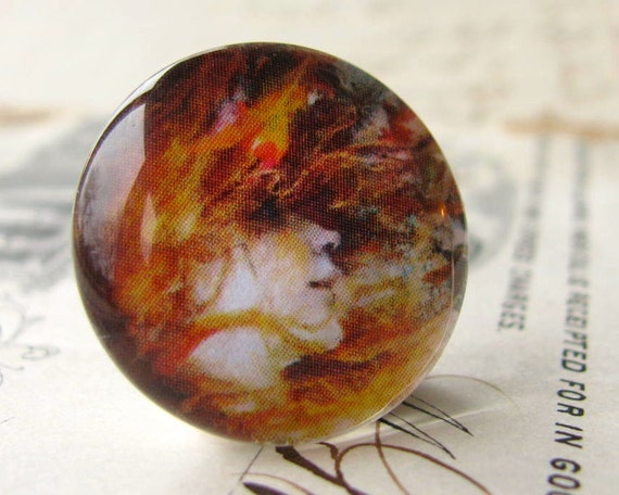 Flaming hair, a gust of wind, autumn leaves, Art Nouveau woman, fall colors, handmade cabochon, glass art cab, round 22mm, flat back image
