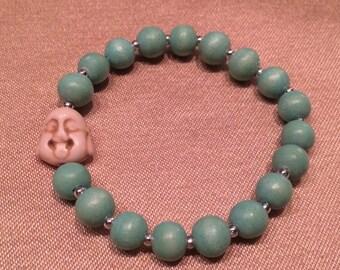 Turquoise wooden beaded Buddha bracelet