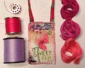 Small textile ornaments, mini art quilts