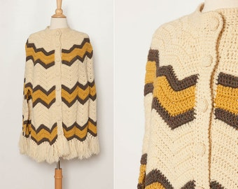 vintage 1970s knit cape poncho with zig zag stripes and buttons