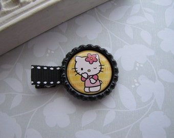 Hello Kitty . bottlecap clippies . girls hair accessory . black yellow