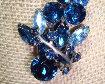 Vintage are Blue Jeweled Flowery Leaf pin.
