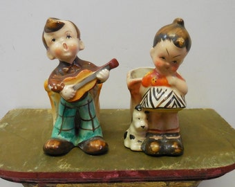 Two vintage Toothpick holders Boy w/  Guitar Girl with spotted dog planters Occupied Japan figurines