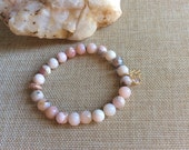 "Pink Opal beaded bracelet with Lotus Charm, Rose Quartz Charm and Rose Gold Crystal Rondelle. 8 mm beads , 7 "" stretchy"