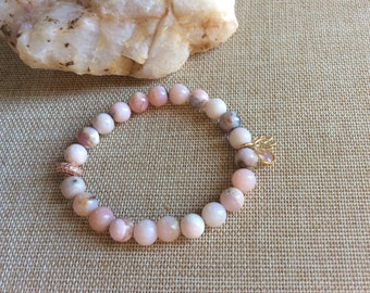 """Pink Opal beaded bracelet with Lotus Charm, Rose Quartz Charm and Rose Gold Crystal Rondelle. 8 mm beads , 7 """" stretchy"""
