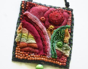 Felted wool necklace decorated with bead embroidery
