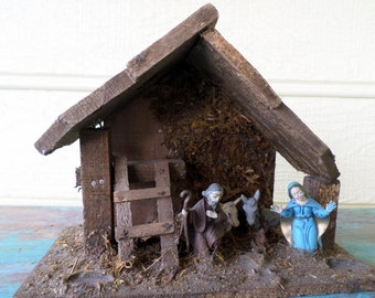cute small wooden nativity set with plastic figures of mary joseph a cow and donkey creche - Wooden Nativity Set