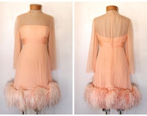 Vintage 1960s Peach/Pink Silk Chiffon Glamorous Cocktail Dress with Ostrich Feather Trim on Hem- Size Medium