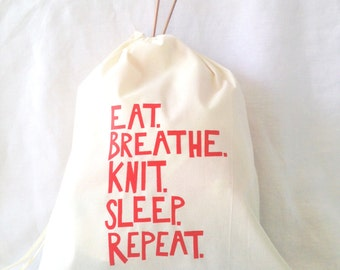 "Silkscreened Drawstring Knitting Project Bag ""Eat, Breathe, Knit, Sleep, Repeat"" in Red"