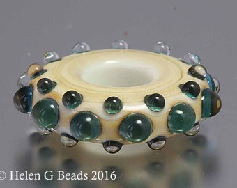 Bumpy, Lampwork Ring or wheel Bead in ivory, green and blue by Helen Gorick