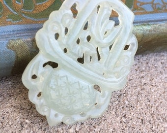 Pale Green Carved Jade Pendant