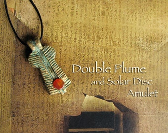 Double Feather and Carnelian Solar Disc Amulet - Swty - Handcrafted Clay Two Feathers Pendant with Golden Brass Patina Finish