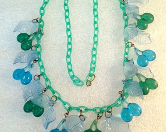 Vintage plastic lucite blue cherries with leaves necklace