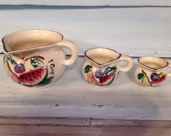 Three pottery measuring cups