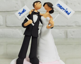 Cute couple with just married banner wedding cake topper