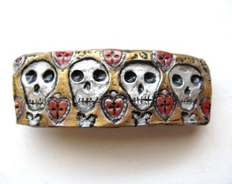 Day of the Dead Barrette Large with Hand Stamped 4 Skull Design in gold, silver and red
