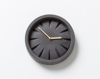 PO Black Concrete Clock with Brass Hands by Plywood Office