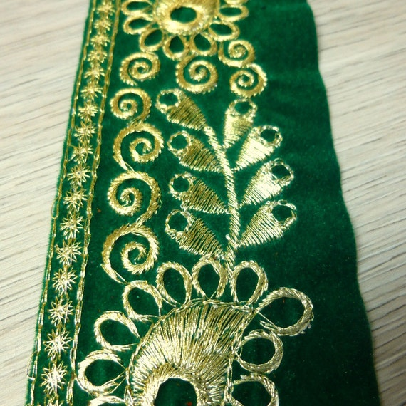 Gold embroidery on green velvet fabric embroidered