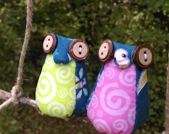 Two hanging mini owls