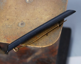 Vintage plastic brooch. Black plastic with brass pin