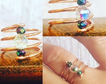 I Love COPPER spiral ring. Multifaceted Swarovski Crystal and Rainbow Hematite beads accent it so well.