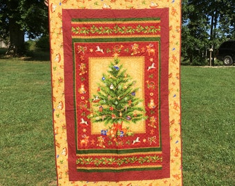 Small quilted Christmas wall hanging quilt. Panel by Northcott
