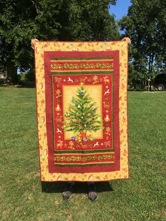 Small quilted christmas wall hanging quilt panel by northcott