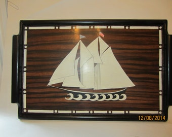 Ship on faux macassar ebony background