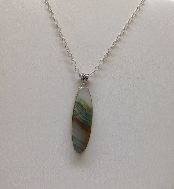 Genuine agate handmade pendant in solid 10 kt yellow gold and sterling silver.
