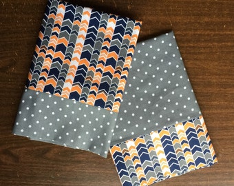 Set of 2 pillow cases in coordinating orange, grey and white patterns standard/queem