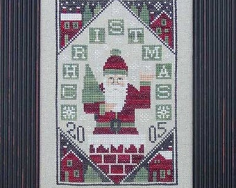 OOP 2005 Limited Edition Here Comes Santa Claus Christmas cross stitch pattern by Prairie Schooler at cottageneedle.com Winter December