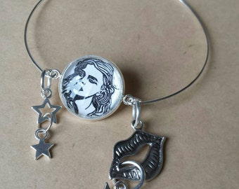 Sale was 11 now 9uk Doodle Designs Pop Art Fashion Lady bangle with Lip and star charms.