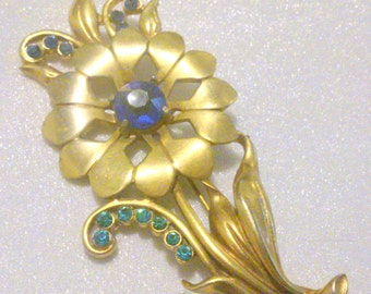 Vintage Gold Tone Blue Rhinestone Flower Brooch