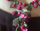SOLD - Polymer clay necklace, floral, lady bugs and berries