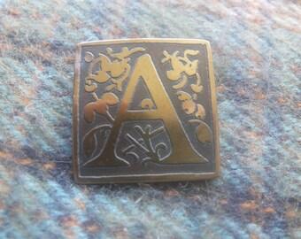 Brass letter A brooch