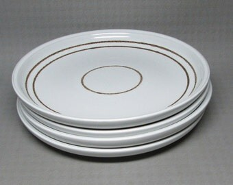 """Denby """" Vanilla """"  salad plates , this is for a set of FOUR  white with brown band / bands"""