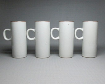 set of four tall mugs , no marks , the colors almost remind me of the dansk brown mist