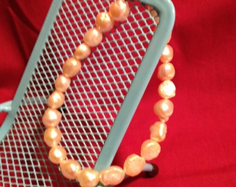 Pearly Wisdom: Handmade Bracelet Featuring Cultured Pearls